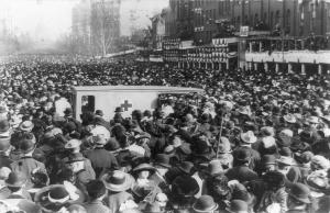 Crowd of spectators blocking the ambulance at 1912 women's march