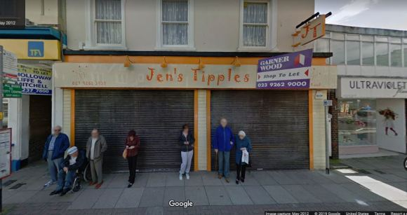 People waiting for bus in front of empty business called Jen's Tipples